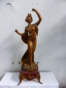 Statuette signed EMILE BRUCHON, in babbitt on a decorated pink marble base, France, around 1900