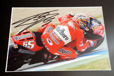 Professionally framed image, personally signed by Loris Capirossi