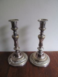 Two yellow copper baroque silver plated candlesticks - France - first half 19th century