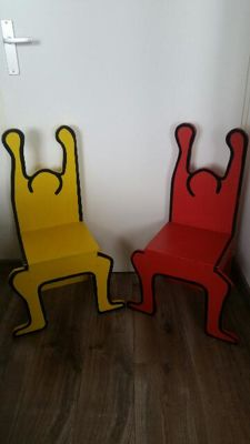 Two wooden high chairs after Keith Haring - late 20th century
