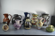 Lot with ten earthenware vases of various designs