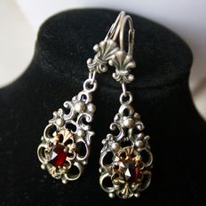 Handcrafted large earrings about 1900 with Bohemian facetted old cut Garnet approx. 5,8x4,8 mm each.