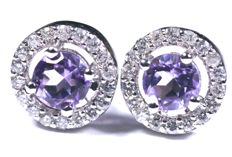 18 kt White gold earrings with 36 diamonds totalling 0.21 ct and amethysts totalling 0.50 ct. Diameter: 7.80 cm.  No reserve price