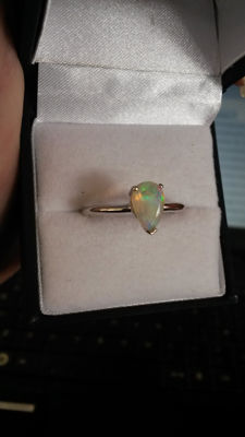 Genuine, stylish 0.79ct Pear Ethiopian Opal dress ring.