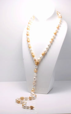 Long White and Golden South Sea Pearlnecklace featuring a Gold Adjustable Clasp
