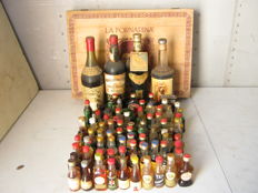 95 miniatures of various liquors between Whiskey and beautiful cognacs with 4 full-size bottles of liqueur wine