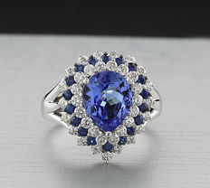 Exclusive richly set tanzanite sapphire brilliant ring, 750 white gold --no reserve price!--