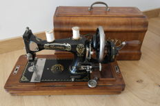 Premier sewing machine with wooden cover, first half 20th century