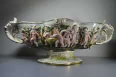 Capodimonte - Generously decorated porcelain dish 'peace and unity in Paradise'