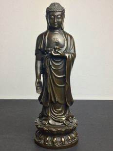 Representation of Buddha in bronze with brown lacquered patina - 1990-1992.