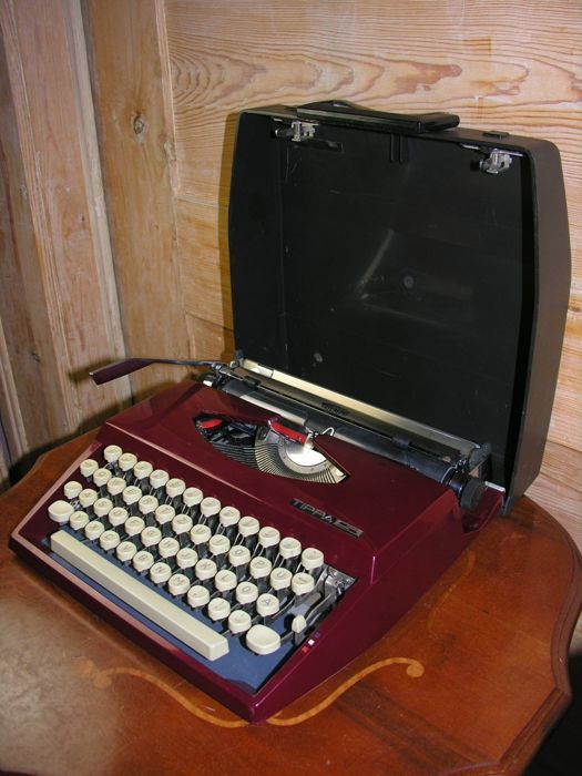 Travel typewriter Adler Tippa S red in suitcase, ca.1968