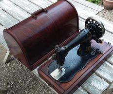 Very old, decorative Singer sewing machine with original cover, 1873