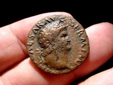 Roman Empire -  Nero (54-68 A.D.), bronze as (8,78 g. 25 mm.) from Lugdunum mint, 67 A.D. Victory holding globe inscribed SPQR.