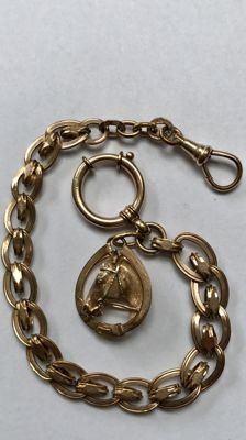 Antique rose gold-coloured watch chain / chatelaine with horse head, around 1900.