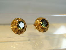 Golden earrings with forest green spinels, weighing 2 ct in total