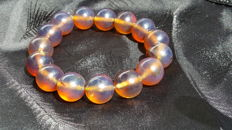 Bracelet of Indonesian Amber beads of  cognac yellow  bluish colour,  not modified, 28.5 grams, no reserve price