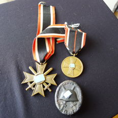 3 Medals, Badges. War merit cross, 2nd class, War merit cross medal and wounded badge in black.