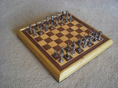 Chess set with classic knight figurines on wooden chessboard