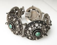 Large silver bracelet with natural stones