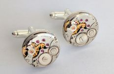 Cufflinks with mechanical movement