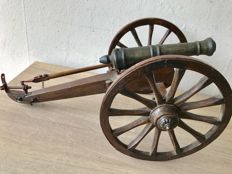 Hand made bronze antique miniature salute cannon on wooden gun carriage with wooden wheels