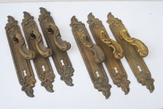 Eight Baroque door handles in brass-Belgium-around 1900.