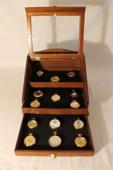 14 exclusive pocket watches with manual winding made of gold and exhibiting showcase - second half of the 20th century