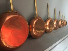 Seven tinned copper frying pans - France - late 20th century