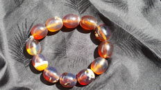 Bracelet of Mexican amber beads of  mix colour, with blue florance  not modified, 27.9 grams, no reserve price