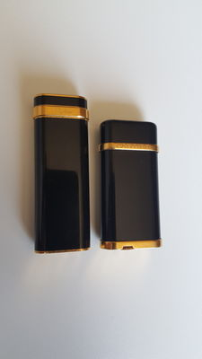 Cartier - pair of gold plated lighters for men women