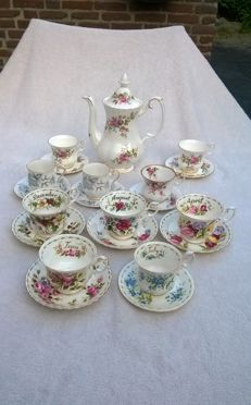 Rare porcelain Royal Albert coffee pot and 10 cups and saucers,  including 5 of the Flowers of the month series. In excellent condition.