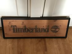 Timberland advertising sign - wood in metal frame