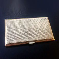 14k gold Elegant box that contained rolling paper for cigarettes.