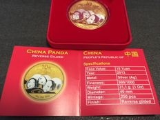 China - 10 Yuan China Panda 999 silver coin reverse gilded finished with 999 gold - edition only 250 pieces