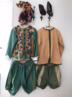 2 Theatre costumes for men on the middle age theme in old fabrics