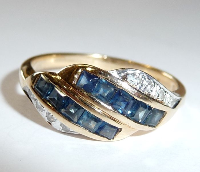 Ring made of 14 kt / 585 gold with 10 sapphires in open channel setting plus 8 diamonds, ring size 58 / 18.4 mm