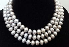 Long necklace composed of freshwater cultured light grey pearls. Length: 132 cm. Pearls size: 11 x 6 mm.
