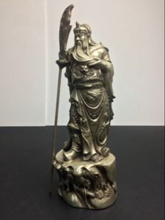 Representation of the God General Guan Gong in a patinated silver alloy - Nepal - late 20th century