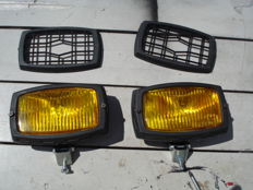 Two beautiful  GERLUX FOG LIGHTS WITH A GUARD with a width of 185 mm from the 1980s and 90s.