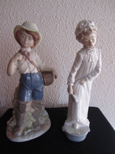 Lot of two figures, a Lladró ('Niña con camisón') and a Nadal ('Niño con cesta'), from the 1980s/1990s