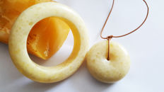 White butter colour Baltic Amber bangle and doughnut pendant, 138 grams
