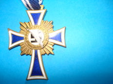 Mother cross in gold with ribbon