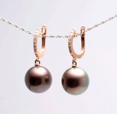 Gold and 0.18Ct Diamond Earrings featuring 12x13mm Round Tahitian Pearls with a swirl of varying colors