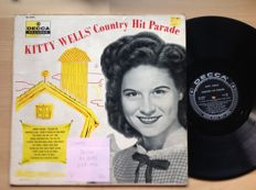 Kitty Wells.....15 LP's + some pages of Country Music oct 2000 with an article about Kitty Wells. records from 1956 till 1972.