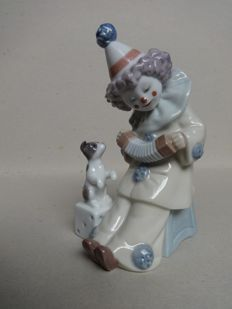 Lladro - porcelain 'Pierrot with Concertina' sculpture, no. 5279.