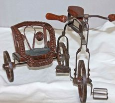 Antique, metal tricycle in rickshaw style.