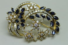Yellow gold brooch with diamonds and sapphires