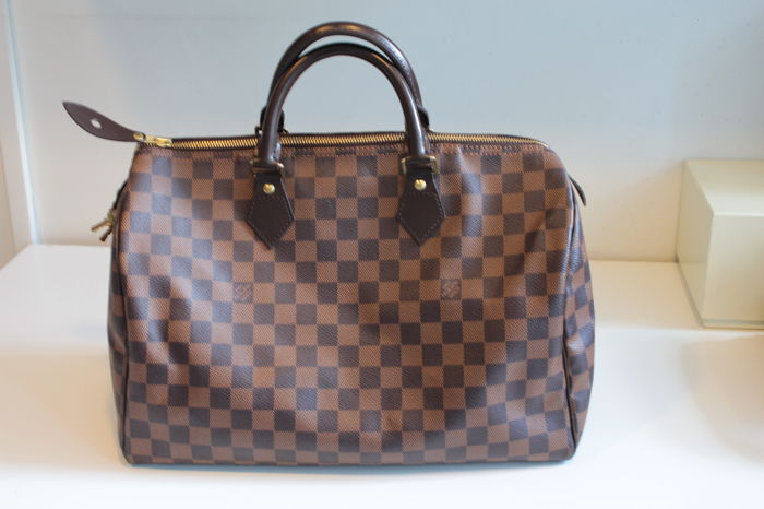 0a0f301c8ffb1d Louis Vuitton – Damier Ebene Speedy 35 – Hand bag - Catawiki