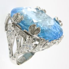Vintage fifties cocktail ring with 75 crt blue topaz and 112 brilliants - 1950
