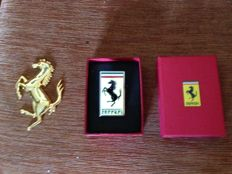 Ferrari Logo length 6 cm and width 3.5 in red box + golden Ferrari prancing horse
